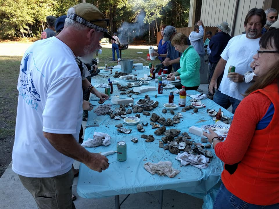 Picture of a group enjoying roasted Oysters